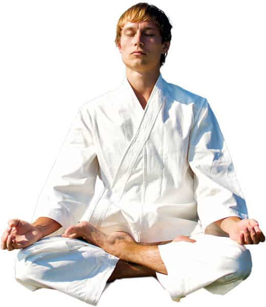 Martial Arts Lessons for Adults in Angleton TX - Young Man Thinking and Meditating in White