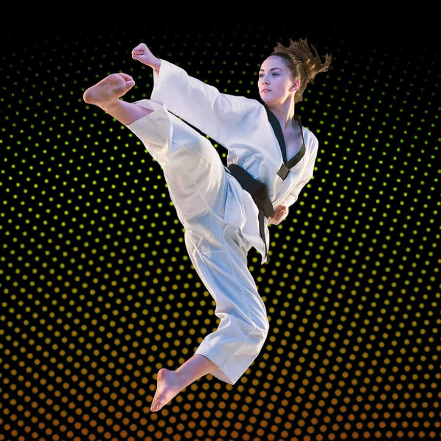 Martial Arts Lessons for Adults in Angleton TX - Girl Black Belt Jumping High Kick