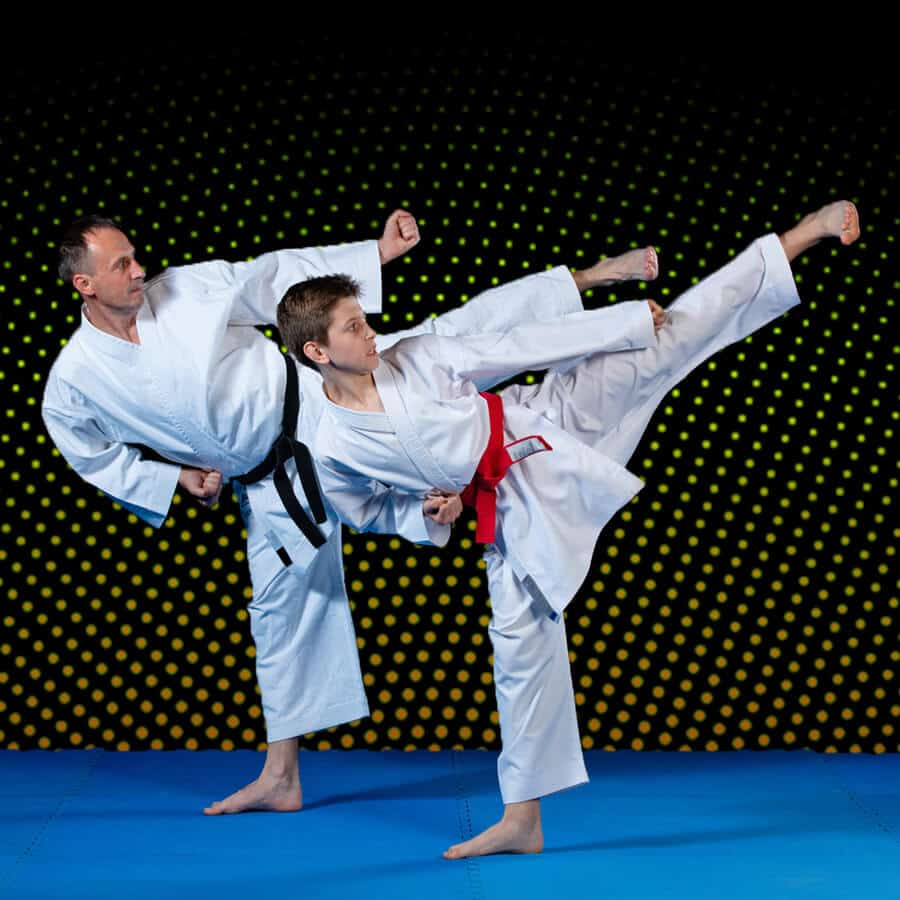 Martial Arts Lessons for Families in Angleton TX - Dad and Son High Kick
